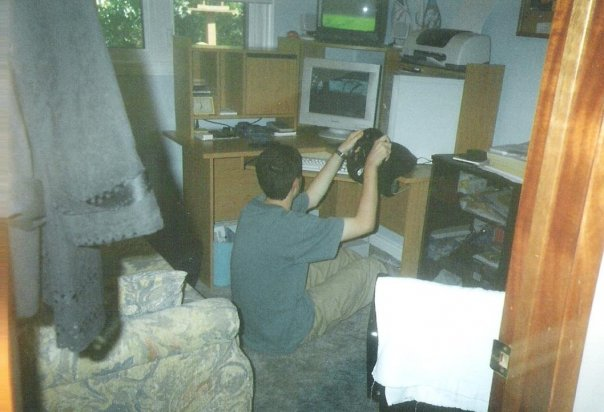 Playing NASCAR Racing 4, which was a present for graduating from High School. I was actually calibrating my MS Sidewinder wheel, in this picture.